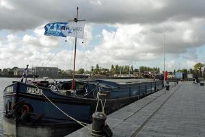 New method to estimate emission quantities at the berths of barges